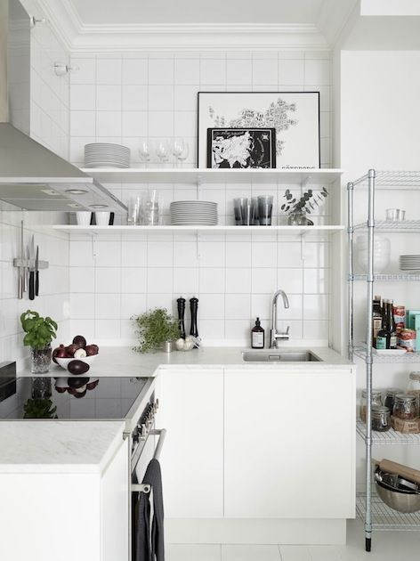 all white Scandinavian minimalist kitchen with silver and black accents