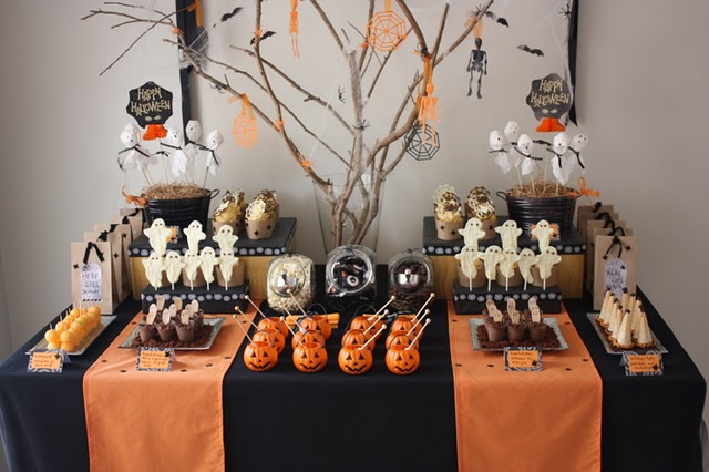 orange and black halloween table layout with halloween tree