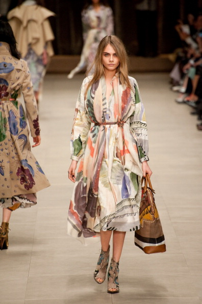 LONDON, ENGLAND - FEBRUARY 17: Model Cara Delevingne walks the runway at the Burberry Prorsum show during the London Fashion Week Autumn / Winter 2014 on February 17, 2014 in London, England. (Photo by Lucie Desmond/isifa/Getty Images)