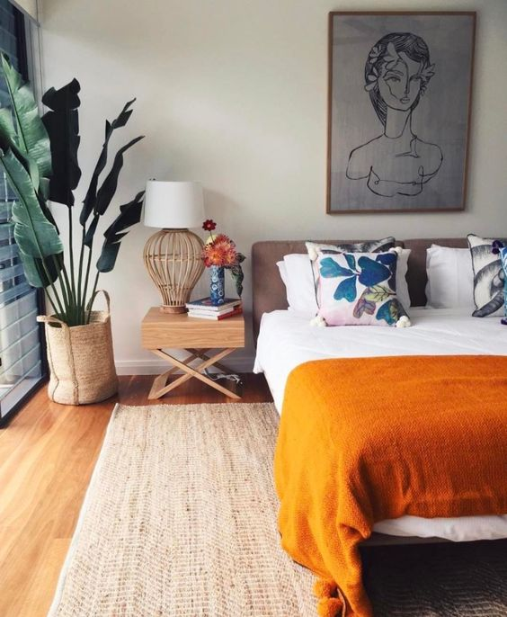 neutral-bedroom-with-orange-home-decor