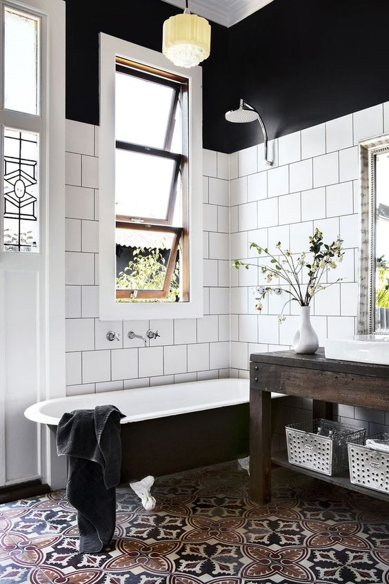 black-bathtub-moroccan-tiled-floor