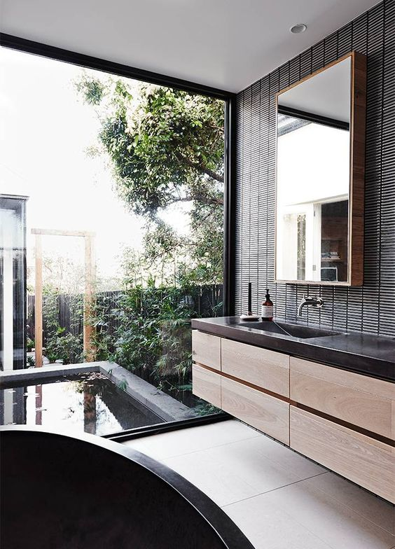 indoor-outdoor-bathroom-black-bath